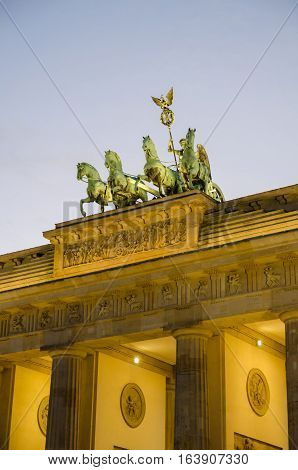 Brandenburger Tor in Berlin with pink evening light and soft clouds, Germany