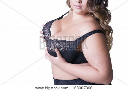 Plus size model in black lingerie overweight female body fat woman with big natural breasts posing isolated on white background