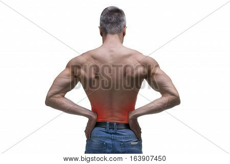 Middle aged man with pain in the kidneys muscular male body studio isolated shot on white background with red dot