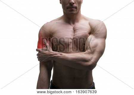 Man with pain in shoulder ache in muscular male body isolated on white background with red dot