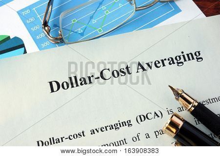 Dollar-cost averaging (DCA) on a paper and charts.