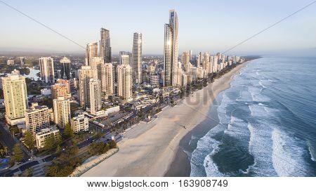 GOLD COAST, AUSTRALIA - DECEMBER 17 2016: Aerial view of Surfers Paradise beach and coastline at sunrise