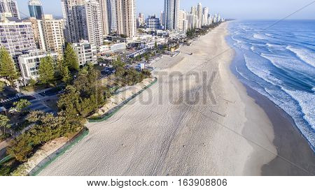 Aerial view looking down on Surfers Paradise beach at sunrise.