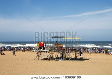 Many  People On Beach Against Ocean And Blue Skyline