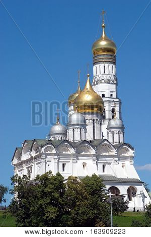 Golden cupolas of Archangel Cathedral and Bell Tower of Ivan The Great in Moscow Kremlin Russia