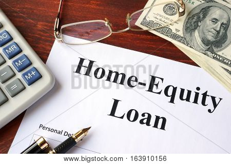 Home-Equity Loan form and documents on a table.
