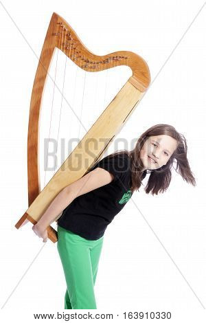 young girl in black shirt with harp on het back in studio against white background