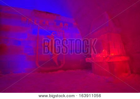 SIBIU ROMANIA - JANUARY 02 2017: Balea Lake ice hotel entrance with blue and red lights. The ice hotel is opened every year from december until february.
