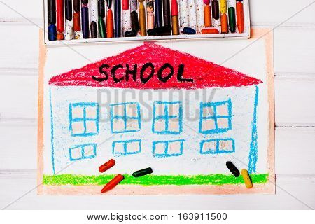 colorful drawing and crayons : school building