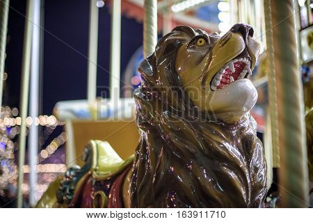 Old French Carousel In A Holiday Park. Lion On Traditional Fairground Vintage . Merry-go-round With
