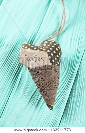 heart with an inscription on a wooden background