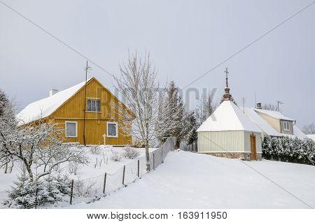 Winter Landscape With Village Houses