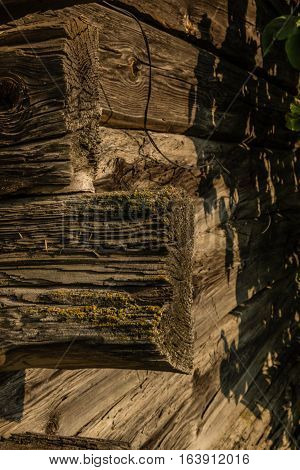 A fragment of an old house made of logs