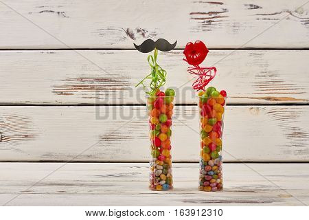 Prop mustache and lips. Vases filled with candy pebbles. Creative and colorful gift.