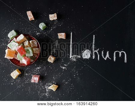 Turkish Delights on a black wooden background