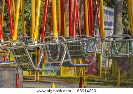 Empty color swings on children playground. Close