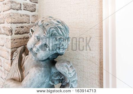 Baby Cupid statue vintage style condolences background
