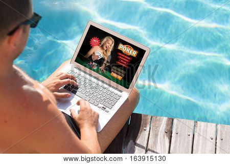 Man playing poker online on portable computer