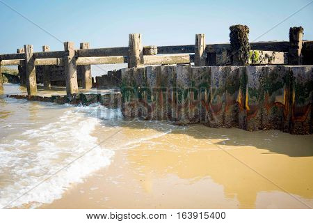 Waves gently lapping agains the wooden sea wall