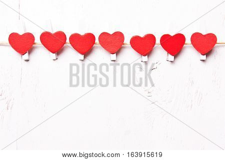 Red hearts in a row congratulatory background