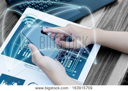 Business People Hands Use Smart Phone And Laptop For Business Analyst Project On Table.