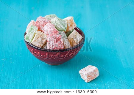 Turkish Delights on a blue wooden background