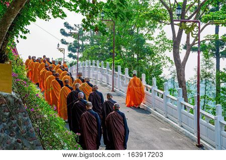 KAOSHIUNG, TAIWAN - NOVEMBER 24: View of monks walking to pray in a temple on Fo Guang Shan a famous Buddhist monastery in Taiwan on November 24, 2016 in Kaoshiung