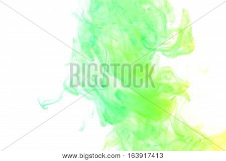 Abstract smoke Weipa. Personal vaporizers fragrant steam. The concept of alternative non-nicotine smoking. Yellow green vape smoke on a white background. E-cigarette. Evaporator. Taking Close-up. Vaping.