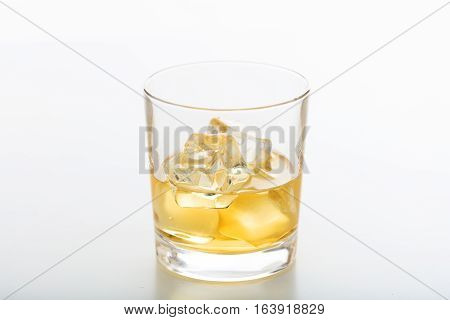 Glass Of Whiskey And Ice On White Background
