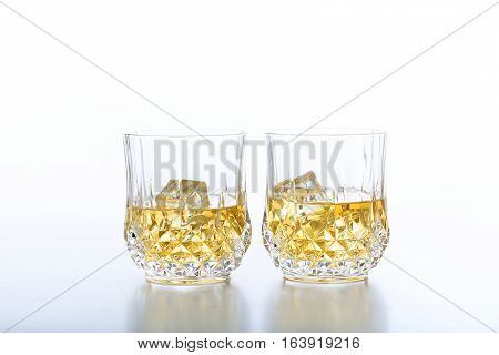 Glasses Of Whiskey And Ice On White Background