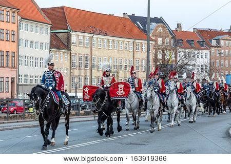 Copenhagen, Denmark - January 04, 2017: The Guard Hussar Regiment preparing for escorting Queen Margrethe in a 24-carat golden coach from Christiansborg Palace to Amalienborg Palace