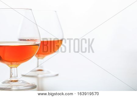 Two Cognac Glasses On White Background