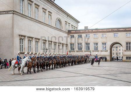 Copenhagen, Denmark - January 04, 2017: The Guard Hussar Regiment awaiting Queen Margrethe in her 24-carat golden coach at Christiansborg Palace