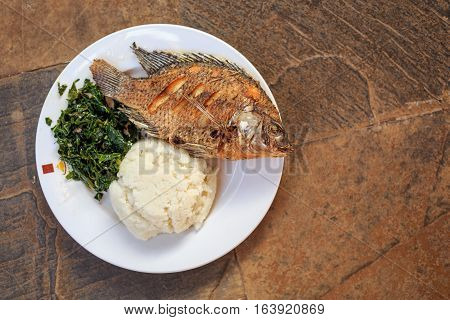 Traditional African Food - Ugali, Fish And Greens