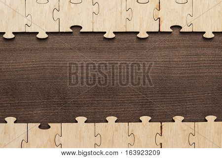 incomplete puzzle pieces on brown wooden table