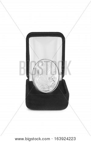 Vintage nacre cameo in black box on white background