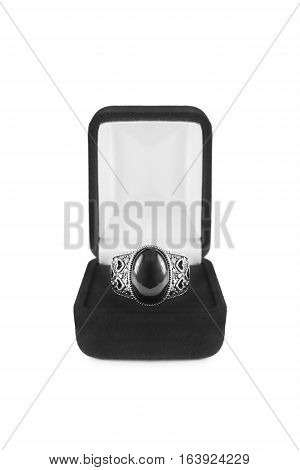 Black onyx ring in jewel box isolated over white