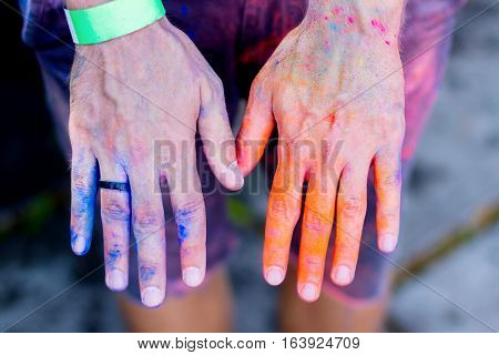 Body parts.Close-up shooting of boy's legs wearing shorts stained with colorful powder