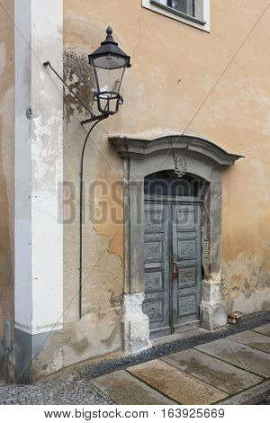 Unrenovated door of a residential home in the town of Goerlitz, Germany