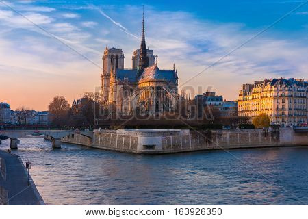 Picturesque cityscape of Cathedral of Notre Dame de Paris at sunset, France