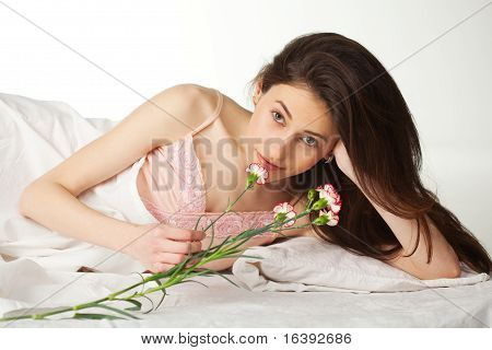 Girl With Flover In The Bed
