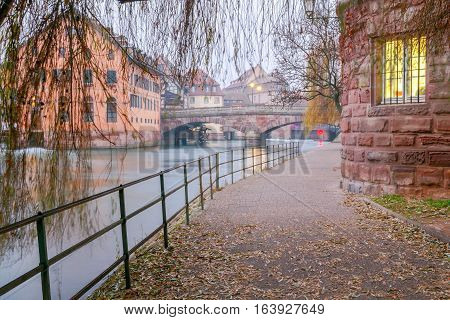 Scenic view of the promenade of St. Thomas in the quarter Petite France at sunset. Strasbourg. Alsace.