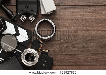 different video making equipment on brown wooden table