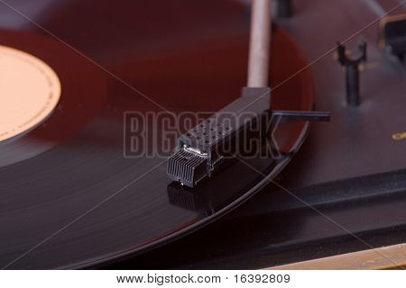 vinyl record playing on turntable poster