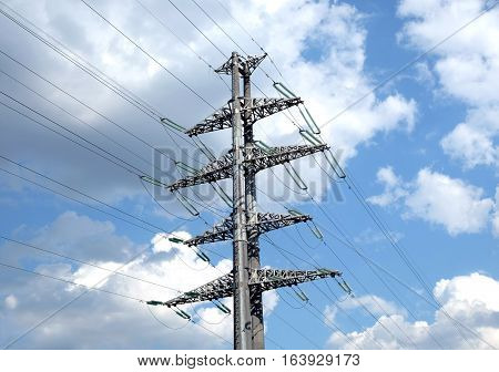 High-voltage power line gray metal prop with many wires closeup view