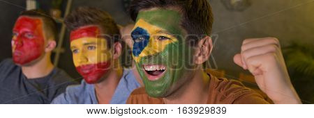 Football Fans' Faces Painted