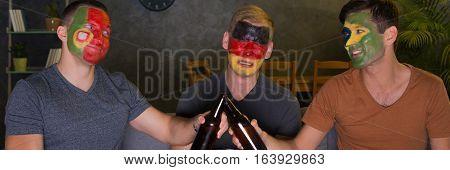 International Football Fans Drinking A Beer