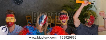 International Fans With Pompoms And Painted Faces
