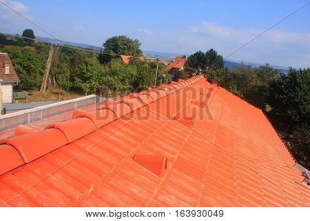 The roof is covered with red concrete tiles