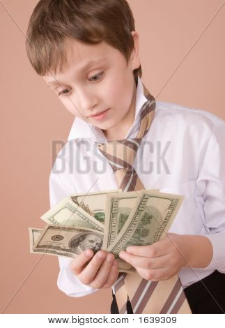 Young Businessman Looking On Money